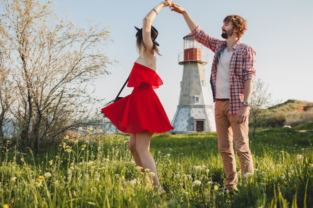Dancing young stylish couple in love in countryside