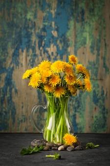 Dandelion flowers on rustic  background.
