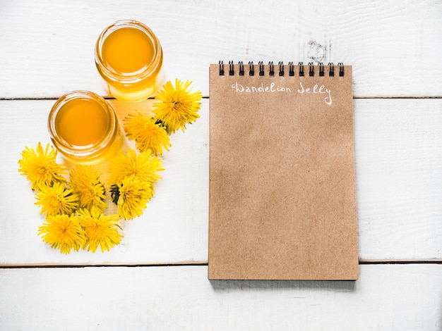 Dandelions and notebook with a blank page