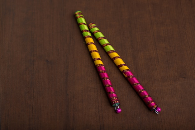 Dandiya sticks on a brown table Premium Photo