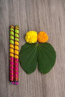 Dandiya sticks on a gray table Premium Photo