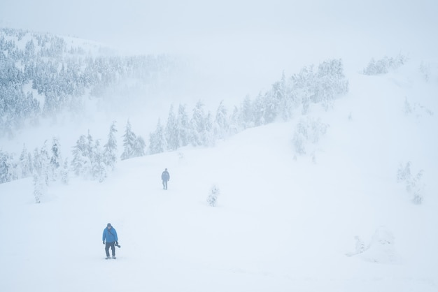 Danger of winter mountains. lost tourists in the fog. bad weather with poor visibility