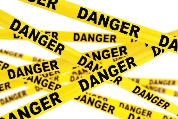 白い背景の上の危険な黄色のテープストリップ