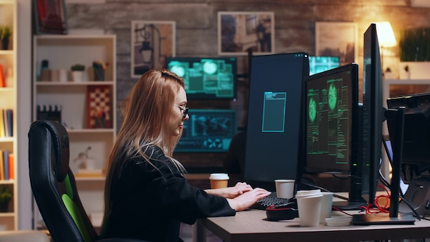 Dangerous cyber criminals working together to bring down the government using super computers. female hacker.