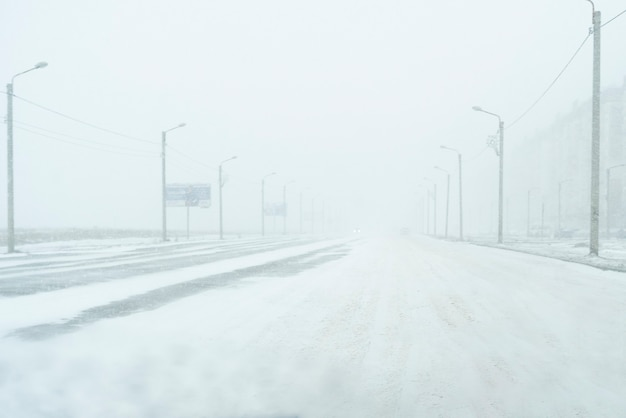A dangerous stormy weather in the city, collapse, snowfall on highway, winter season