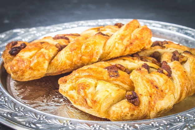 Danish pastry maple pecan with nuts and maple syrup