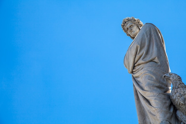 Dante's statue in front of santa croce church - florence, italy