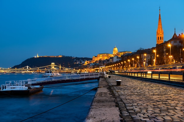 Danube waterfront in pest with a view over chain bridge and buda castle
