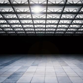 セメントの床と暗くて空の倉庫