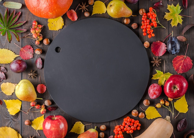 Dark autumn background with chalk board. flat lay.