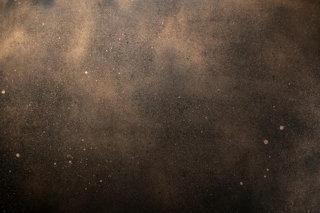 暗い背景。テクスチャーブラックとゴールドのペイント。