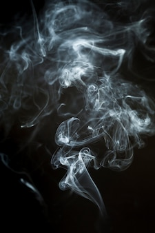 Dark background with dynamic smoke silhouette