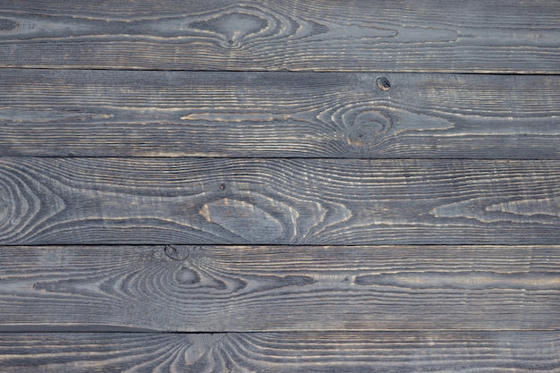 Dark background of wooden texture boards with paint residues. horizontal.