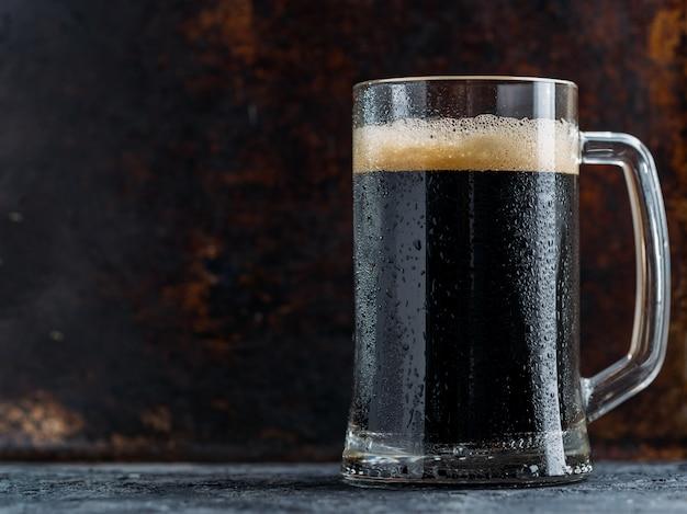 Dark beer mug on rustic dark background