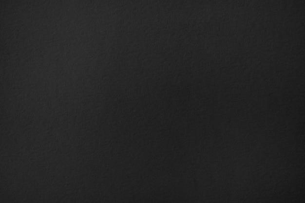 Темно-черная бумага текстуры фона