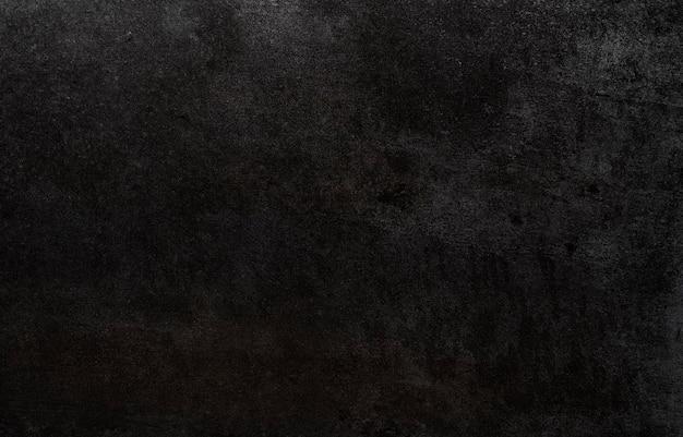 Темно-черный камень текстуры фона