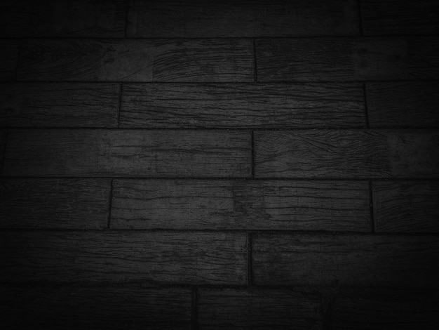 Dark black wooden texture background.