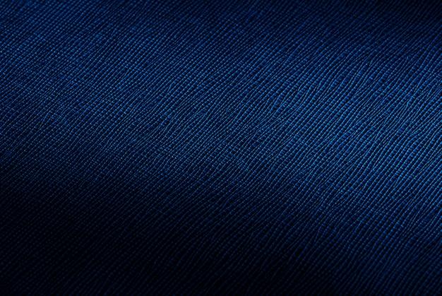 光のスポットと暗い青色の抽象的なテクスチャ背景