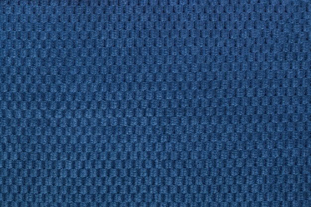 Dark blue background from soft fleecy fabric closeup