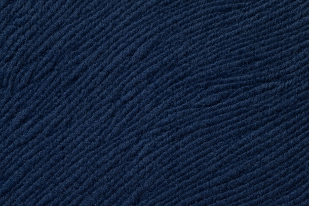 Dark blue background from soft textile material, fabric with natural texture,