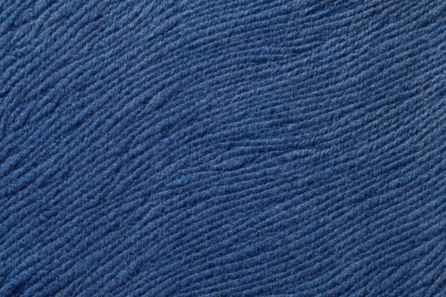 Dark blue background from soft textile material. fabric with natural texture.