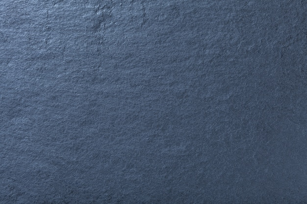天然スレート、石のテクスチャの暗い青色の背景