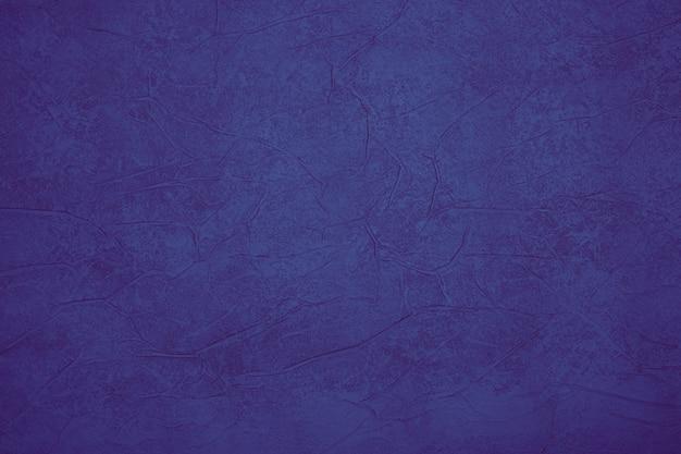 진한 파란색 배경 텍스처입니다. 디자인에 대 한 질감 된 벽입니다.