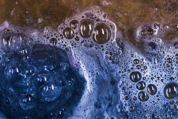 Dark blue bath bomb in water