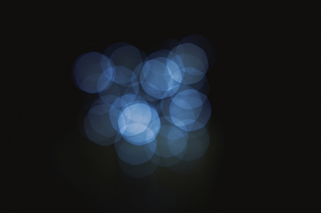 Dark blue bokeh abstract light background defocused