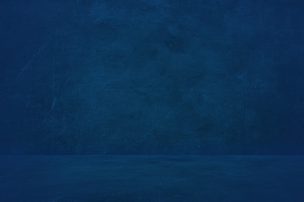 Dark blue cement wall background, empty showroom to present product