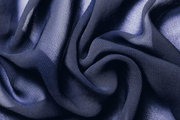 紺色の布生地のテクスチャ背景