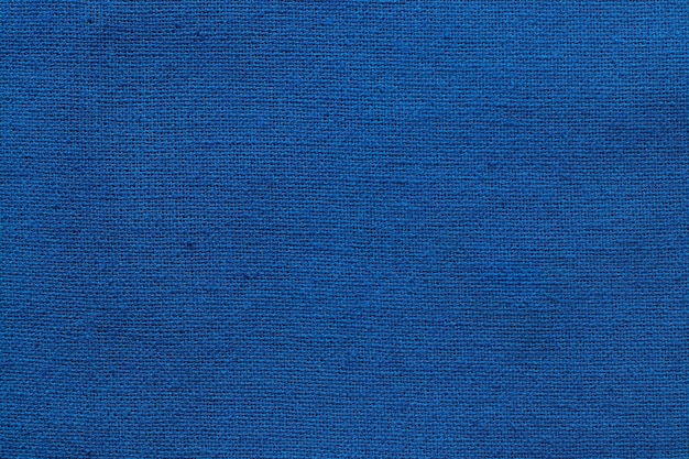 Dark blue cotton fabric cloth texture background, seamless pattern of natural textile.