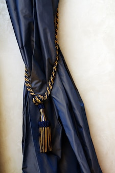 Dark blue curtains with rope