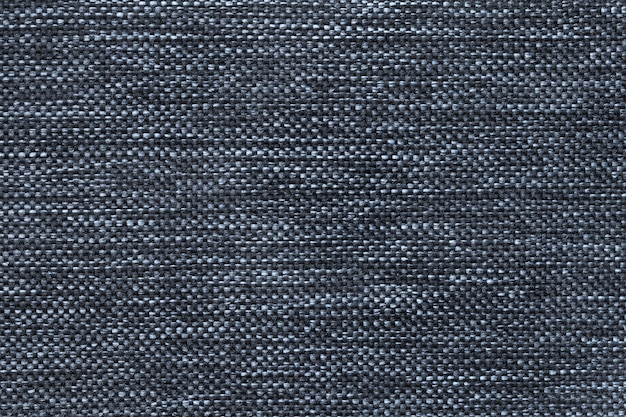 Dark blue of dense woven bagging fabric, closeup. structure of the textile macro.