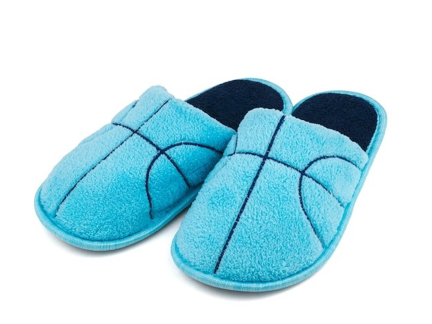 Dark blue embroidery on blue slippers isolated on white surface
