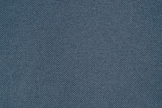 Dark blue fabric texture of cloth that is structurally textile fabric fibers background