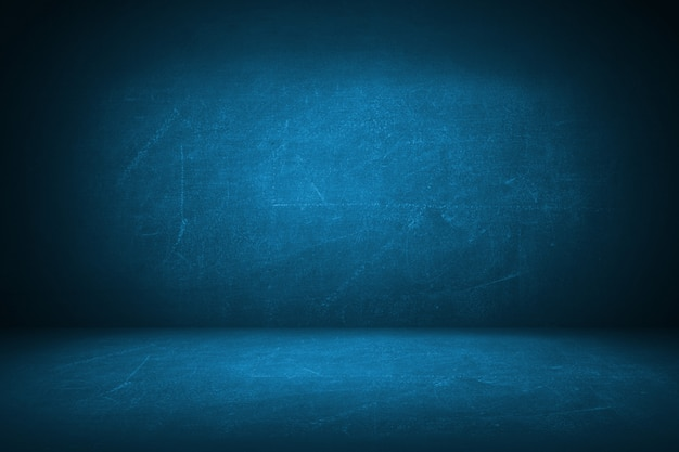 Dark blue grunge studio backdrop background
