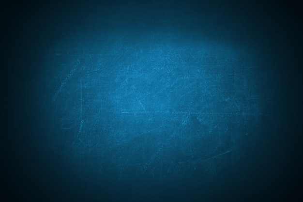 Dark blue grunge texture chalkboard backdrop background
