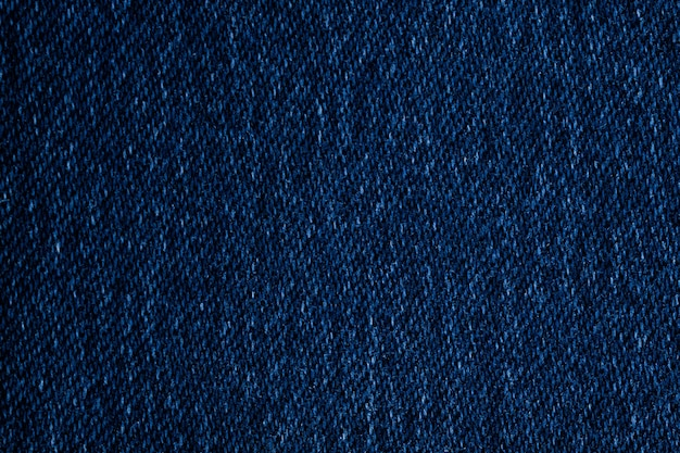 Dark blue jeans fabric texture, surface close up background