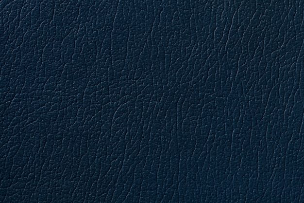 Dark blue leather texture background with pattern, closeup.