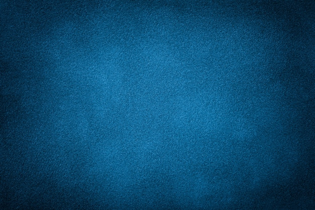 Dark blue matte background of suede fabric