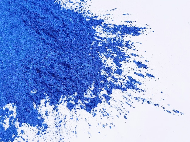 Dark blue mica pigmet powder on white background