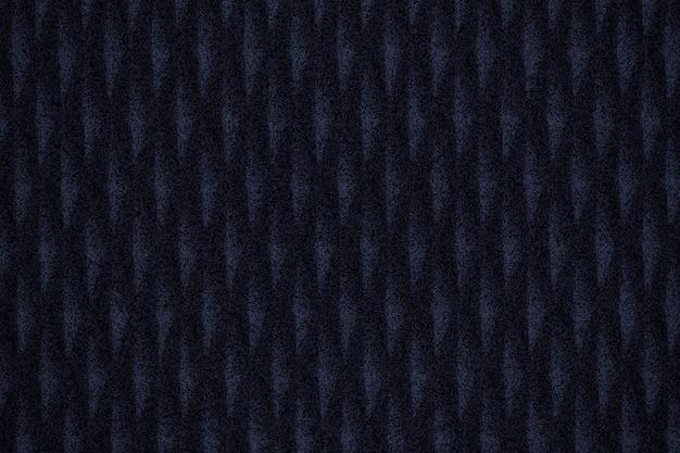 ダークブルーの柄の生地の織り目加工の背景