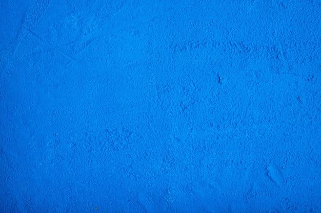 Dark blue porous concrete background