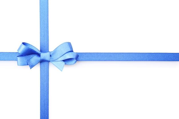 白で隔離の紺色のリボンの弓