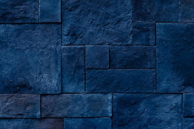 暗い青い石の壁の背景