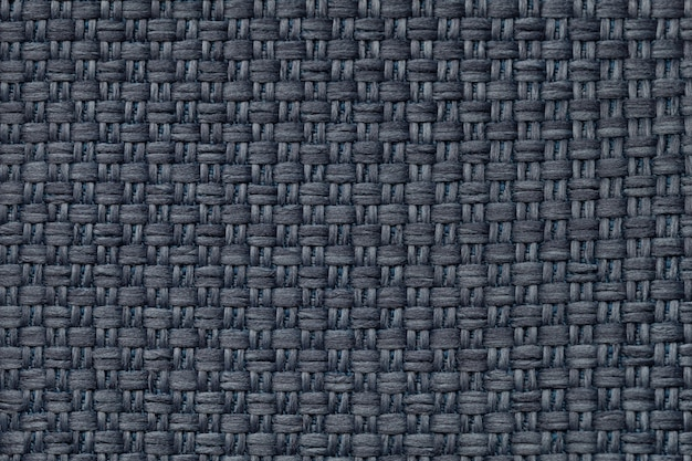 Dark blue textile background with checkered pattern, closeup. structure of the fabric macro.