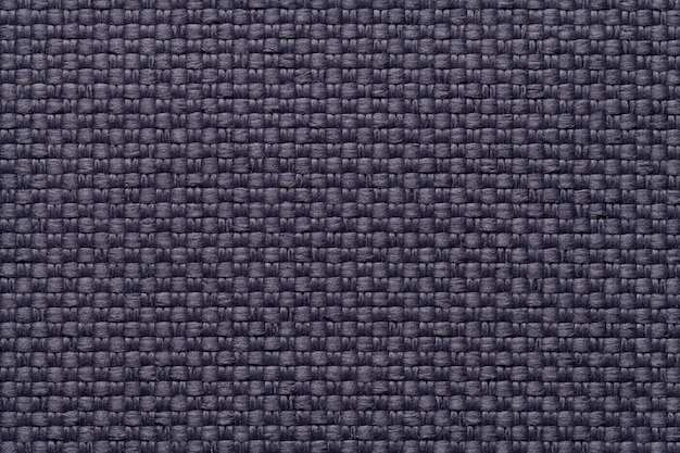 Dark blue textile background with checkered pattern, closeup  structure of the fabric macro