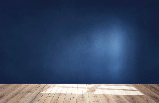 Dark blue wall in an empty room with a wooden floor