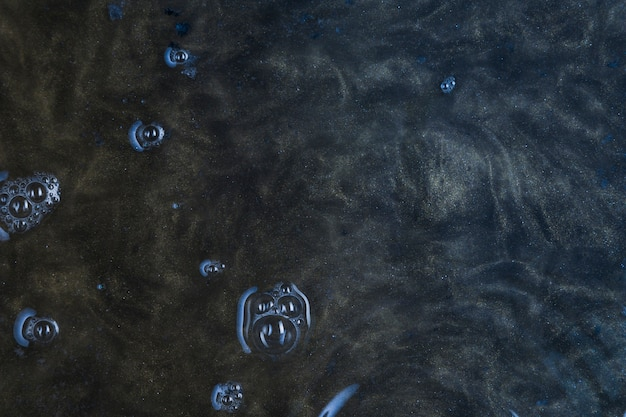 Dark blue water with bubbles